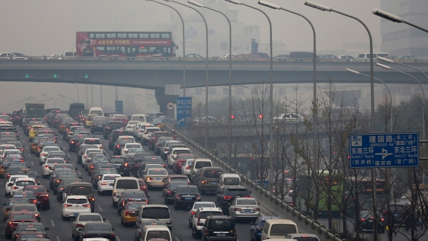 Beijing Puts a Cap on Sale of New Car to Curb Pollution